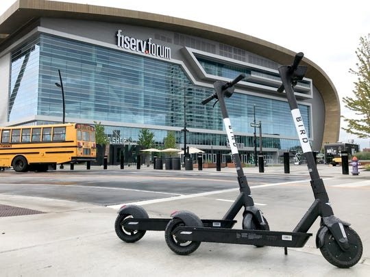 Bird electric scooters sit outside Fiserv Forum on Aug. 14, 2019.