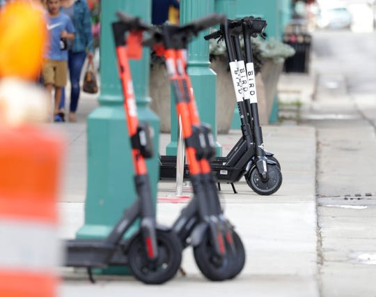 Spin and Bird electric scooters in the Third Ward in Milwaukee on Wednesday, Aug. 14, 2019.   - Photo by Mike De Sisti/Milwaukee Journal Sentinel