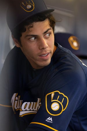 Milwaukee Brewers' Christian Yelich hangs out in the dugout before the Minnesota Twins face the Milwaukee Brewers Tuesday, August 14, 2019 at Miller Park in Milwaukee, Wis.Colin Boyle/Milwaukee Journal Sentinel