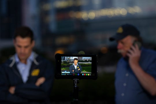 """Rob Marciano (left) and Rob Hess of """"Good Morning America"""" prepare to film their weather segment next to the Milwaukee Art Museum in Milwaukee."""