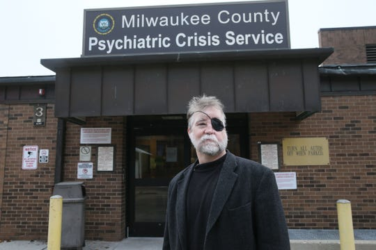 John H. Schneider, chief medical officer of the Milwaukee County Behavioral Health Division, stands in front of the county's Psychiatric Crisis Center, an acute care emergency department that is slated to close in two years.