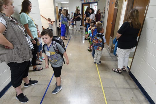 Mountain Home kindergartners travel to their classrooms Wednesday morning.