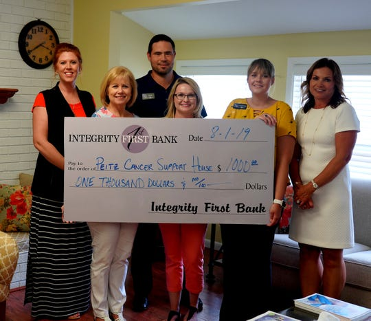 Employees from Integrity First Bank recently donated $1,000 to the Peitz Cancer Support House in memory of Barbara Williams. Pictured are: (from left) Jaren Beavers,IFB-VP/Marketing; Cindy Costa, Baxter Regional Hospital Foundation Director of Development; Scott Copeland, IFB Market President and former PCSH Advisory Board Chair; Melissa Hudson, PCSH Coordinator; Courtney Jesse, IFB-Loan Assistant; and Shonda Litty, IFB-AVP/Human Resources.