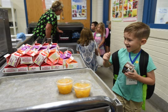 A Mountain Home kindergartner goes through the breakfast line Wednesday morning. Five area schools returned to classroom instruction Wednesday.