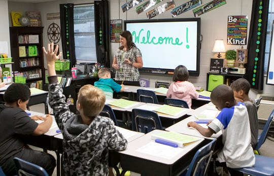 Boley Elementary School fourth grade teacher Brittani Durand speaks to her class on the first day of school at the temporary location of the school in West Monroe, La. on Aug. 14. The original location of the school burned in a fire on April 13.