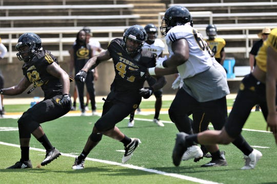 Grambling State redshirt freshman defensive end Dantrieze Scott (47) rushes around the edge during a fall camp practice.