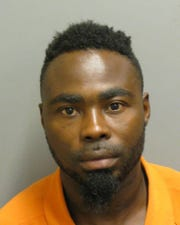 Taurice King was charged with shooting into  an occupied vehicle or building.