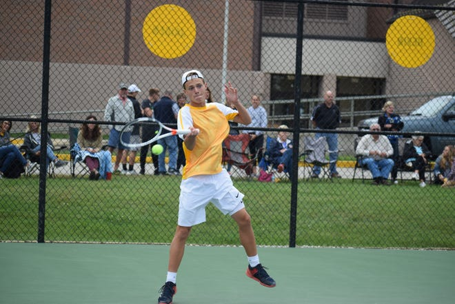 Delta tennis player Brandon Jackson hits a ball during a 2018 sectional match.