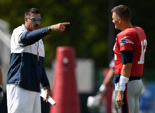 Tennessee Titans head coach Mike Vrabel chats with New England Patriots quarterback Tom Brady (12) during a joint training camp practice at Saint Thomas Sports Park Wednesday, Aug. 14, 2019 in Nashville, Tenn.