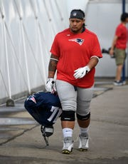 New England Patriots defensive tackle Danny Shelton (71) arrives for a joint training camp practice against the Tennessee Titans at Saint Thomas Sports Park Wednesday, Aug. 14, 2019 in Nashville, Tenn.