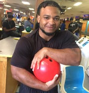 Tennessee State running back Seth Rowland, like the rest of the Tigers, were excited to hear they didn't have to practice Wednesday and instead got to bowl at Donelson Strike & Spare Lanes.