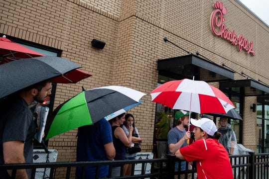 Hopefuls line up to enter the raffle to see if they will secure one of the 100 spots to camp out the evening before the opening of the new Chick-fil-A at 1122 Murfreesboro Road in Franklin, Tenn., Tuesday, Aug. 13, 2019. The first 100 customers will receive gift cards for a year's worth of free meals.