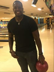 Christion Abercrombie, the Tennessee State linebacker who suffered a severe head injury last season, joined his teammates at Donelson Plaza Strike and Spare Bowling alley Wednesday.