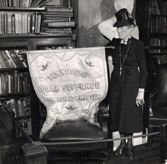 Mrs. Joseph H. Acklen poses with the past Tennessee suffrage flag Jan. 18, 1948.