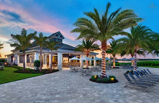 The 10,000-square-foot Barefoot Bar & Grill features a pool bar, dining room and bar, and a multi-purpose room for community events and private parties.