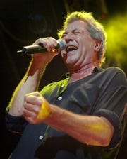 Ian Gillan, singer of the legendary British rock group Deep Purple, performs with the group at the Rock Oz'Arenes festival in Avenches, Switzerland, late Wednesday, August 13, 2003. (AP Photo/ Keystone, Fabrice Coffrini)