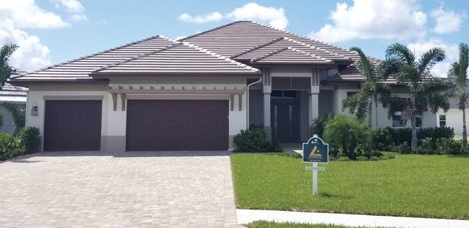 The Belvedere II model home at Parrot Cay in Naples Reserve is open daily.