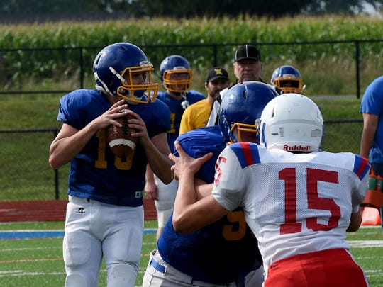 West Muskingum's Harley Hopkins drops back for a pass against Lakewood in a scrimmage earlier this month. Hopkins will step in as the Tornadoes' starting quarterback.