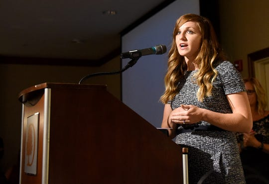 Melissa Owens accepts the award for Young Professional of the Year during the Licking County Chamber of Commerce's 16th Annual Gala on Tuesday, Aug. 13, 2019, at the DoubleTree by Hilton in Newark.