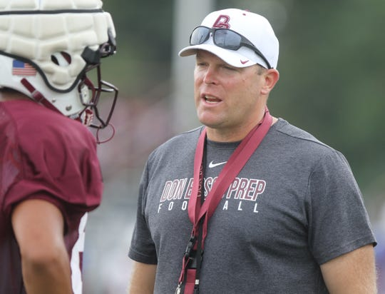 Don Bosco football's new head coach Dan Sabella talks with his players during their scrimmage against Millville on August 14, 2019 at the Rutgers football practice field in Piscataway, NJ.