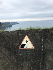 This sign posted at the Cliffs of Moher in Ireland warn visitors not to climb over the wall. Nevertheless, psychology professor Dr. Charlotte Markey observed several people ignoring it and scaling the wall to take selfies on the other side.