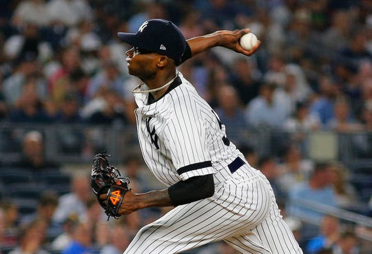 Aug 13, 2019; Bronx, NY, USA; New York Yankees starting pitcher Domingo German (55) pitches against the Baltimore Orioles during the seventh inning at Yankee Stadium.