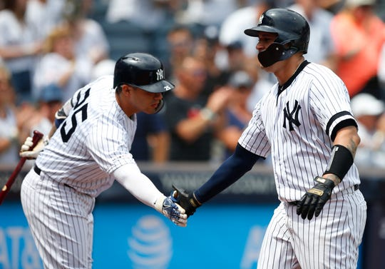 New York Yankees catcher Gary Sanchez (right) is congratulated by second baseman Gleyber Torres (25) after hitting a home run against the Baltimore Orioles in the first inning at Yankee Stadium.