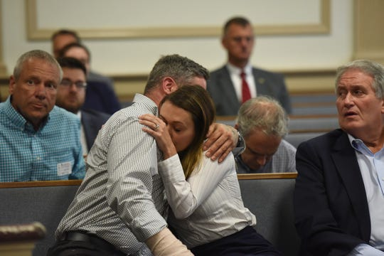 Michael Barisone, not pictured, a former and is charged with attempted murder in the shooting of Lauren Kanarek, who trained with Barisone and Kanarek's fiancee Robert Goodwin, appeared in Morris County Superior Court for a detention hearing on August 14, 2019. Kanarek's sister hugs Goodwin after Barisione is denied release.
