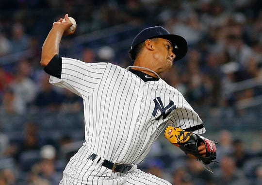 Aug 13, 2019; Bronx, NY, USA; New York Yankees relief pitcher Adonis Rosa (73) making his major league debut pitches against the Baltimore Orioles during the eighth inning at Yankee Stadium.