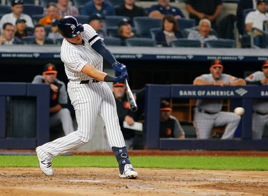 Aug 13, 2019; Bronx, NY, USA; New York Yankees third baseman Gio Urshela (29) singles against the Baltimore Orioles during the third inning at Yankee Stadium.