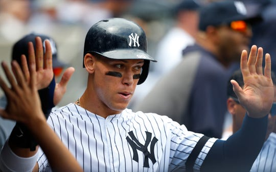 Aug 14, 2019; Bronx, NY, USA; (Editors Notes: Caption Correction) New York Yankees right fielder Aaron Judge (99) celebrates in the dugout after scoring a run against the Baltimore Orioles at Yankee Stadium. Mandatory Credit: Noah K. Murray-USA TODAY Sports