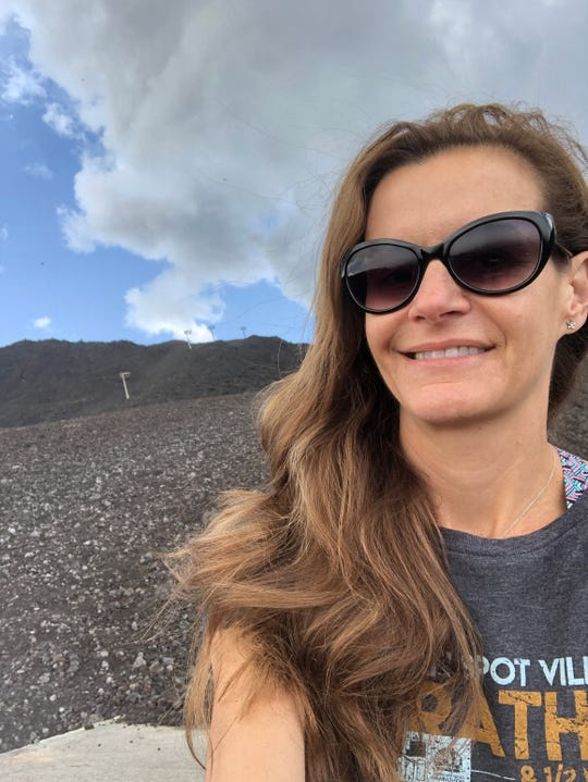 Dr. Charlotte Markey, professor of psychology at Rutgers-Camden, takes a selfie in front of Mt. Etna in Sicily.