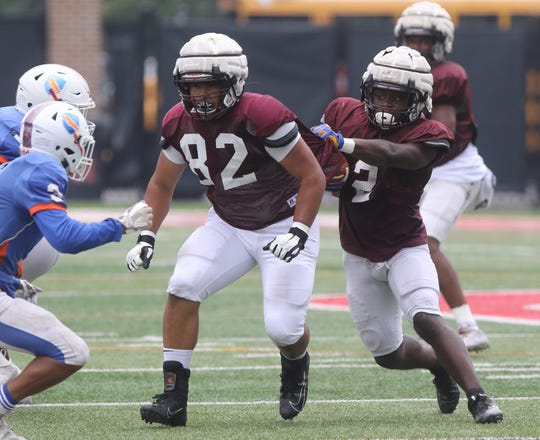 Don Bosco back Kyle Monangai looks for running room in a scrimmage against Millville on August 14, 2019 at the Rutgers football practice field in Piscataway, NJ.