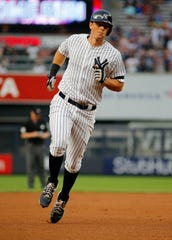 Aug 13, 2019; Bronx, NY, USA; New York Yankees first baseman DJ LeMahieu (26) rounds the bases after hitting a solo home run against the Baltimore Orioles during the first inning at Yankee Stadium.