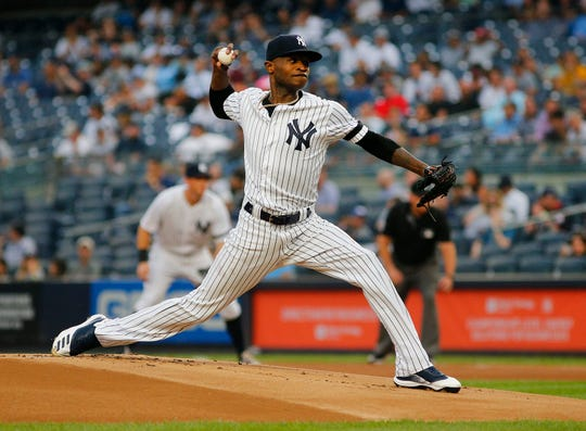 Aug 13, 2019; Bronx, NY, USA; New York Yankees starting pitcher Domingo German (55) pitches against the Baltimore Orioles during the first inning at Yankee Stadium.