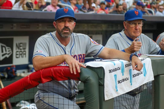 Aug 13, 2019; Atlanta, GA, USA; New York Mets manager Mickey Callaway (36) and interim pitching coach Phil Regan (58) in the dugout against the Atlanta Braves in the first inning at SunTrust Park. Mandatory Credit: Brett Davis-USA TODAY Sports