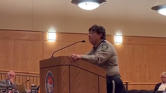 Sheriff Kim Stewart accuses county manager Fernando Macias, seated nearby, of retaliation after she filed a discrimination complaint against him.