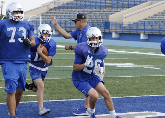 Kaden Smith (11) takes a QB keeper for a score during Wednesday's walkthrough. Carlsbad travels to Lovington to scrimmage the Wildcats on Thursday. The Cavemen start the season at home hosting Artesia on Aug. 23.