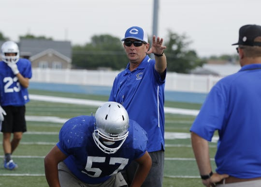 Cavemen head coach Gary Bradley goes over directions during a Wednesday's practice. Carlsbad travels to Lovington to scrimmage the Wildcats on Thursday. The Cavemen start the season at home hosting Artesia on Aug. 23.
