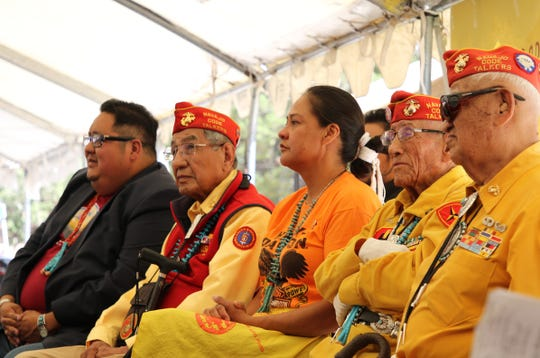 New Mexico Sen. Shannon Pinto, center, sits with Navajo Code Talkers during the Navajo Code Talkers Day honoring ceremony on Aug. 14 in Window Rock, Arizona. Pinto's grandfather, John Pinto, was a code talker.