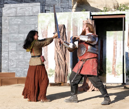 "Kiana Poafpybitty and Tom Jennings square off against each other, Tuesday, Aug. 13, 2019, during a rehearsal for the Theater Ensemble Arts production of ""Robin Hood."""