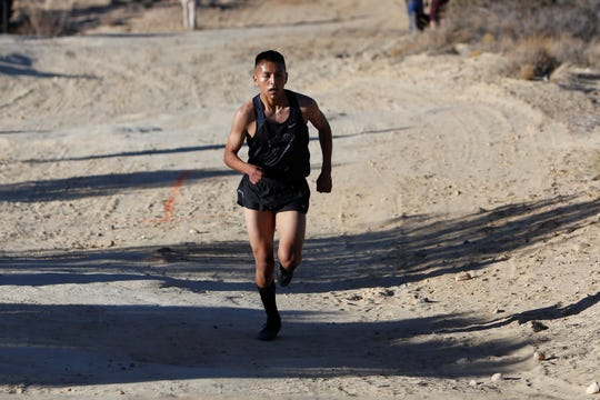 Piedra Vista's Triston Charles darts up the trail during the District 2-5A cross country championships on Friday, Nov. 2, 2018 at Pinon Hills Community Church in Farmington.