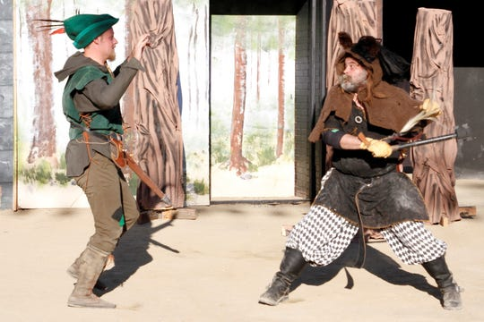 "Kevin Tschetter, left, and Chuck Holmes do battle in a scene from the Theater Ensemble Arts production of ""Robin Hood."""