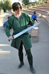 "Brit Ward displays his sword during a rehearsal for the Theater Ensemble Arts production of ""Robin Hood."""