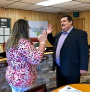 Tim Dodge recited his oath of office Tuesday as he became Ruidoso's new village manager. Village Clerk Irma Devine administered the oath.