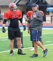 Livonia Franklin football coach Chris Kelbert talks to his troops during an Aug. 14, 2019 practice.