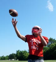 Canton quarterback Ben Stesiak throws during an Aug. 14 practice.