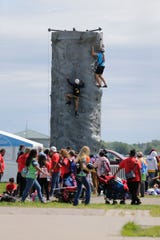 Rock climbing was one of the activities to do Wednesday, Aug. 14, 2019, at the Pathfinders convention on the EAA grounds in Oshkosh, Wis. About 55,000 people were on hand to take part in the event, which happens every five years on the EAA grounds.