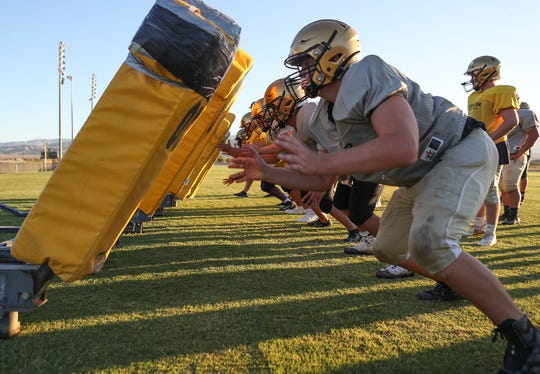 The Xavier Prep Saints linemen push a sled during football practice in Palm Desert, August 14, 2019.