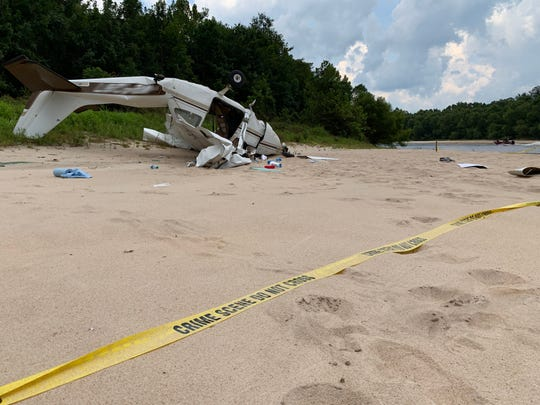 A small plane crashed into a sandbank along the banks of the Escambia River, near the end of Oil Plant Road at about 1 p.m. Tuesday.